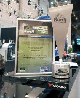 Innovation Award commendation and trophy on display at YOKOHAMA booth at REIFEN 2014