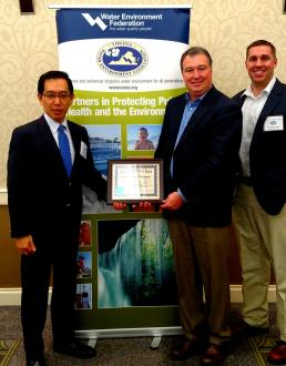 YTMV President Tetsuro Murakami, Director of Environmental Health and Safety Neil Dalton and EHS staff member Christian Yates (left to right) proudly pose with the Environmental Warrior Award.