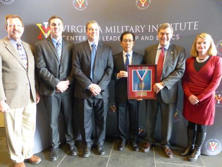 YTMV President Tatsuro Murakami (third from right) accepting the Governor's Environmental Excellence Award
