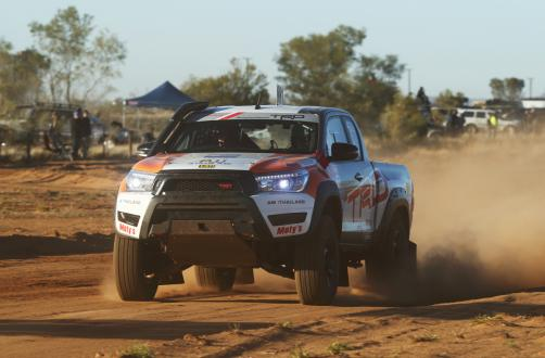 TRD's Toyota Hilux racing across the desert sand